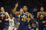 Utah Jazz guard Donovan Mitchell, center, gestures after scoring during the second half of the team's NBA basketball game against the Los Angeles Clippers on Saturday, Dec. 28, 2019, in Los Angeles. The Jazz won 120-107. (AP Photo/Mark J. Terrill)