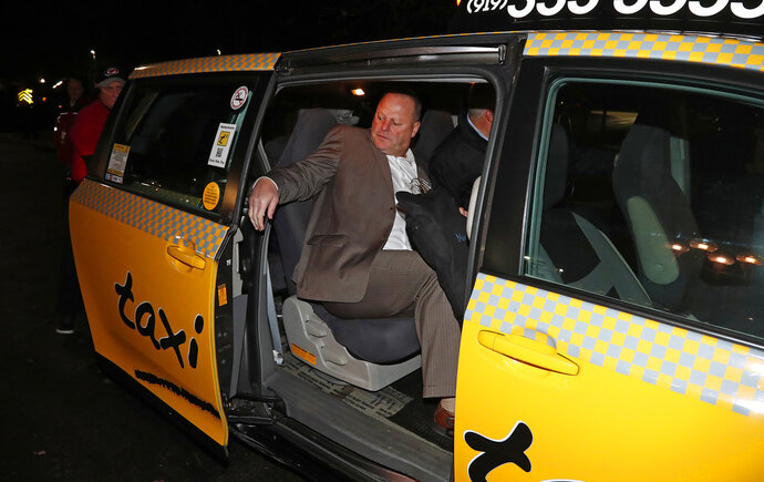 FILE - In this Nov. 27, 2016, file photo, Gerard Gallant, former Florida Panthers head coach, gets into a cab after being relieved of his duties following an NHL hockey game against the Carolina Hurricanes in Raleigh, N.C. The Western Conference final features two coaches — Gerard Gallant of Vegas, Paul Maurice of Winnipeg — who have taken long, winding roads to perhaps the best teams of their careers. (AP Photo/Karl B DeBlaker, File)