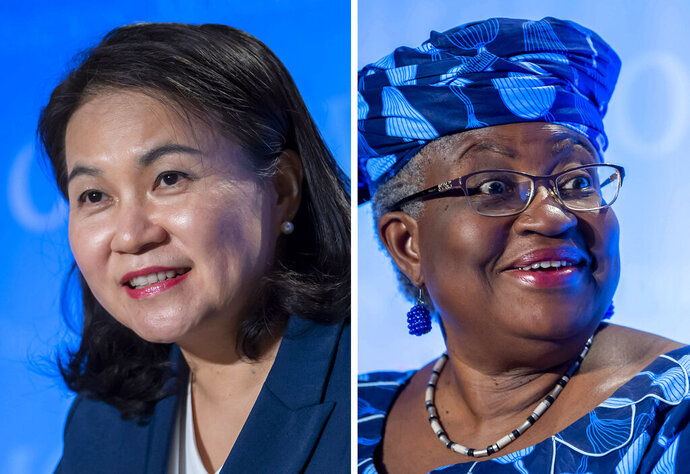 FILE - This  file photo combo shows the candidates for the WTO Director-General selection process at the headquarters of the World Trade Organization (WTO) in Geneva, Switzerland, pictured from Wednesday to Friday, July 15 - 17, 2020, Yoo Myung-hee, of Korea, left and Ngozi Okonjo-Iweala, of Nigeria. The World Trade Organization says South Korea's trade minister and a Harvard-trained former Nigerian finance minister have qualified as the two finalists to become the next director-general, ensuring a woman in the top job for the first time. WTO spokesman Keith Rockwell said Thursday, Oct. 8, 2020 that a selection committee found Ngozi Okonjo-Iweala of Nigeria and Yoo Myung-hee of South Korea qualified for the final round in a race expected to end in the coming weeks. (Martial Trezzini, Salvatore Di Nolfi/Keystone via AP, File)