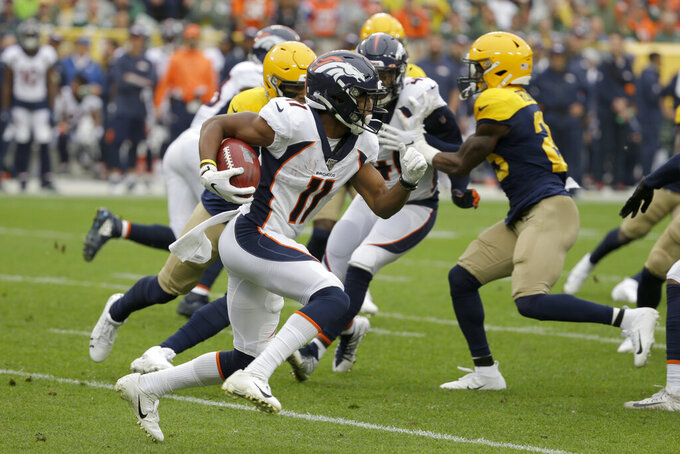 Denver Broncos wide receiver Diontae Spencer (11) runs with the ball during the first half of an NFL football game against the Green Bay Packers, Sunday, Sept. 22, 2019, in Green Bay, Wis. (AP Photo/Mike Roemer)