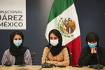 Several of the original members of the Afghan all-girls robotics team, who have received threats from the Taliban, attend a press conference after arriving at the Benito Juarez International Airport in Mexico City, Tuesday, Aug. 24, 2021. After extensive international efforts and coordination from a diverse group of volunteers to evacuate the team, the girls are now begging the international community to help get their family to safety with them. (AP Photo/Eduardo Verdugo)