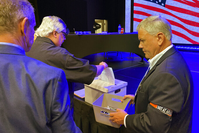Republicans vote for party officers at the 6th Congressional District convention in Alpharetta, Ga., on Saturday, May 15, 2021. Republicans gathered in congressional district conventions across the state. (AP Photo/Jeff Amy)