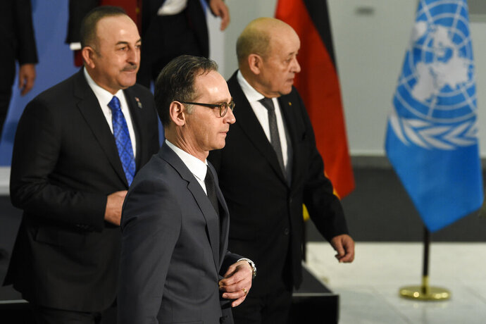 From left: Turkish Foreign Minister Mevlut Cavusoglu, German Foreign Minister Heiko Maas and French Foreign Minister Jean-Yves Le Drian arrive for a meeting about Libya alongside the Munich Security Conference in Munich, Germany, Sunday, Feb. 16, 2020. (AP Photo/Jens Meyer)