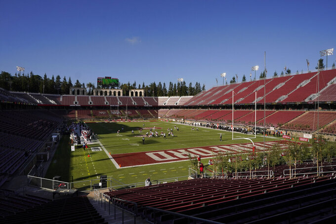 Empty seats at Stanford Stadium are shown during the first half of an NCAA college football game between Stanford and Colorado in Stanford, Calif., Saturday, Nov. 14, 2020. (AP Photo/Jeff Chiu)