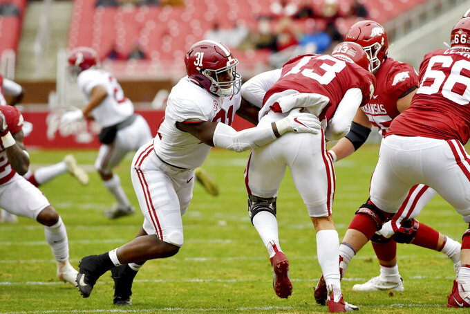 Arkansas quarterback Feleipe Franks (13) is tackled for a loss by Alabama defender Will Anderson Jr. (31) during the first half of an NCAA college football game Saturday, Dec. 12, 2020, in Fayetteville, Ark. (AP Photo/Michael Woods)