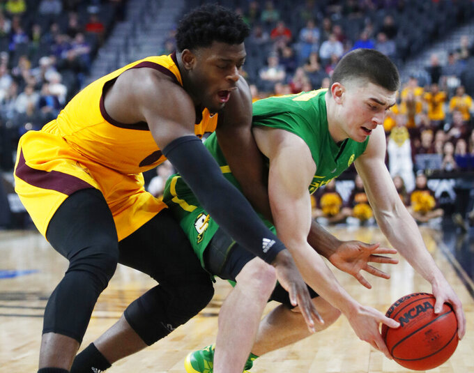 Arizona State's Mickey Mitchell, left, and Oregon's Payton Pritchard scramble for the ball during the second half of an NCAA college basketball game in the semifinals of the Pac-12 men's tournament Friday, March 15, 2019, in Las Vegas. (AP Photo/John Locher)