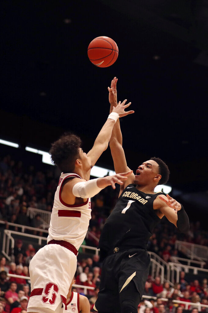 Colorado forward Tyler Bey (1) shoots against Stanford guard Tyrell Terry, left, during the first half of an NCAA college basketball game in Stanford, Calif., Sunday, March 1, 2020. (AP Photo/Jed Jacobsohn)