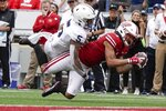 Wisconsin's Danny Davis III catches a pass near the goal line with Penn State's Tariq Castro-Fields defending during the second half of an NCAA college football game Saturday, Sept. 4, 2021, in Madison, Wis. (AP Photo/Morry Gash)