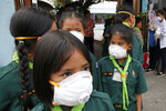 Thai students wear protective masks at Boonlert Anusorn school in Songkhla province, southern Thailand, Thursday, Sept. 19, 2019. Thailand's southernmost provinces, which are north of Malaysia halfway up the Malay Peninsula, were blanketed with haze from Indonesian forest fires on Thursday. (AP Photo/Sumeth Panpetch)