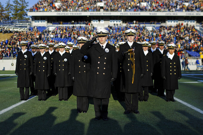 U.S. Naval Academy Midshipmen stand in formation on the field before an NCAA college football game against Tulsa, Saturday, Nov. 17, 2018, in Annapolis, Md. (AP Photo/Patrick Semansky)