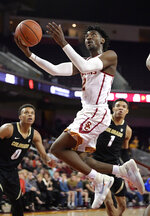 Southern California guard Jonah Mathews shoots as Colorado guard Shane Gatling, left, and guard Tyler Bey defend during the second half of an NCAA college basketball game Saturday, Feb. 9, 2019, in Los Angeles. Colorado won 69-65. (AP Photo/Mark J. Terrill)