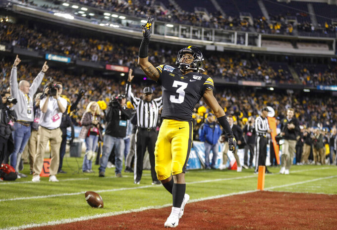 FILE - In this Dec. 27, 2019, file photo, Iowa freshman running back Tyrone Tracy Jr., runs the ball for a touchdown against USC in the first quarter during the Holiday Bowl NCAA college football game in San Diego. Big Ten is going to give fall football a shot after all. Less than five weeks after pushing football and other fall sports to spring in the name of player safety during the pandemic, the conference changed course Wednesday, Sept. 16, 2020, and said it plans to begin its season the weekend of Oct. 23-24. (Bryon Houlgrave/The Des Moines Register via AP, File)