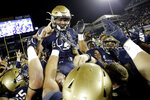 Navy kicker Bijan Nichols is hoisted by teammates after kicking a game-winning field goal as time expired during an NCAA college football game against Tulane, Saturday, Oct. 26, 2019, in Annapolis. Navy won 41-38. (AP Photo/Julio Cortez)