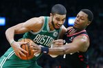 Toronto Raptors' Kyle Lowry, right, defends against Boston Celtics' Jayson Tatum during the first half of an NBA basketball game in Boston, Friday, Oct. 25, 2019. (AP Photo/Michael Dwyer)