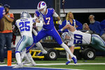 Dallas Cowboys safety Xavier Woods (25) and linebacker Sean Lee (50) defend as Buffalo Bills quarterback Josh Allen (17) reaches the end zone for a touchdown in the second half of an NFL football game in Arlington, Texas, Thursday, Nov. 28, 2019. (AP Photo/Michael Ainsworth)