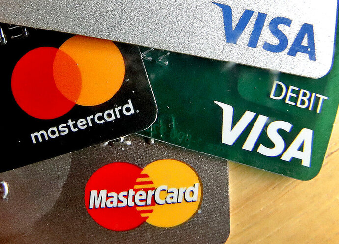 FILE - In this Feb. 20, 2019, file photo,  credit cards are displayed in Zelienople, Pa. U.S. consumer borrowing rose in June after three months of declines but the key category of credit card debt extended its decline. (AP Photo/Keith Srakocic, File)