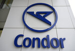 The Condor airline logo on an airline building in Frankfurt airport, Friday Jan. 24, 2020.  The owner of Polish carrier LOT is taking over German airline Condor, a subsidiary of collapsed tour operator Thomas Cook, according to an announcement Friday. (Boris Roessler/dpa via AP)