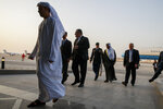 U.S. Secretary of State Mike Pompeo, center, walks with U.S. Charge d'Affaires Steve Bondy, second from left, after being greeted by United Arab Emirates Minister of State Ahmed al-Sayegh, fifth from left, as Pompeo arrives in Abu Dhabi, United Arab Emirates, Monday, June 24, 2019, for talks on Iran. (AP Photo/Jacquelyn Martin, Pool)