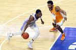 Kentucky's Keion Brooks Jr., left, drives as Tennessee's Josiah-Jordan James defends during the second half of an NCAA college basketball game in Lexington, Ky., Saturday, Feb. 6, 2021. (AP Photo/James Crisp)