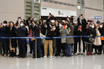 People take photos of South Korean director Bong Joon-ho upon his arrival at the Incheon International Airport in Incheon, South Korea, Sunday, Feb. 16, 2020. South Koreans are reveling in writer-director Bong's dark comic thriller,