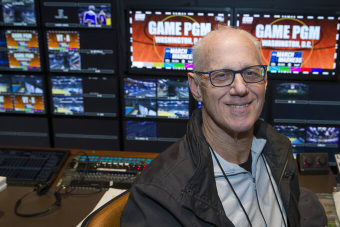 In this Thursday, March 28, 2019, photo, CBS director Bob Fishman poses in the production truck in Washington, D.C. Fishman is preparing to direct his 38th Final Four this week in Minneapolis. If anyone can speak about the growth of the NCAA Tournament on television it is Fishman. (AP Photo/Alex Brandon)