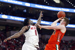 North Carolina State forward D.J. Funderburk (0) defends while Miami forward Sam Waardenburg (21) shoots during the second half of an NCAA college basketball game in Raleigh, N.C., Wednesday, Jan. 15, 2020. (AP Photo/Gerry Broome)