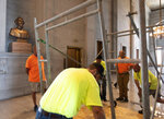 Workers prepare scaffolding in front of a bust of Confederate general and early Ku Klux Klan leader Nathan Bedford Forrest at the State Capitol Thursday, July 22, 2021, in Nashville, Tenn. A decadeslong effort to remove the bust from the Tennessee Capitol cleared its final hurdle Thursday, with state leaders approving the final vote needed to allow the statue to be relocated to a museum. (George Walker IV/The Tennessean via AP)