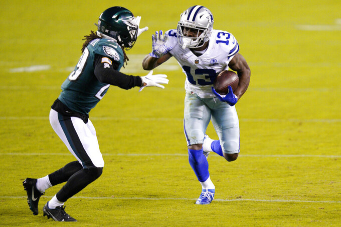 Dallas Cowboys' Michael Gallup (13) tries to get past Philadelphia Eagles' Avonte Maddox (29) during the second half of an NFL football game, Sunday, Nov. 1, 2020, in Philadelphia. (AP Photo/Chris Szagola)