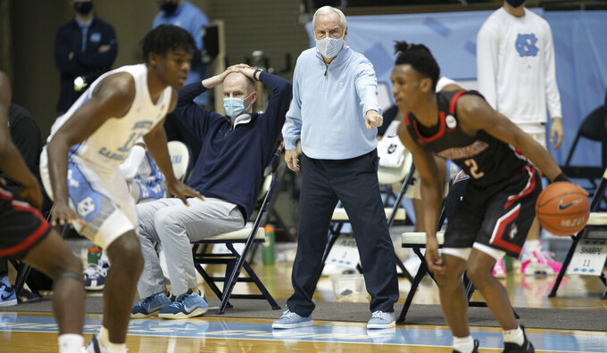 North Carolina coach Roy Williams directs the team on defense in the first half against Northeastern in an NCAA college basketball game Wednesday, Feb. 17, 2021, in Chapel Hill, N.C. (Robert Willett/The News & Observer via AP)
