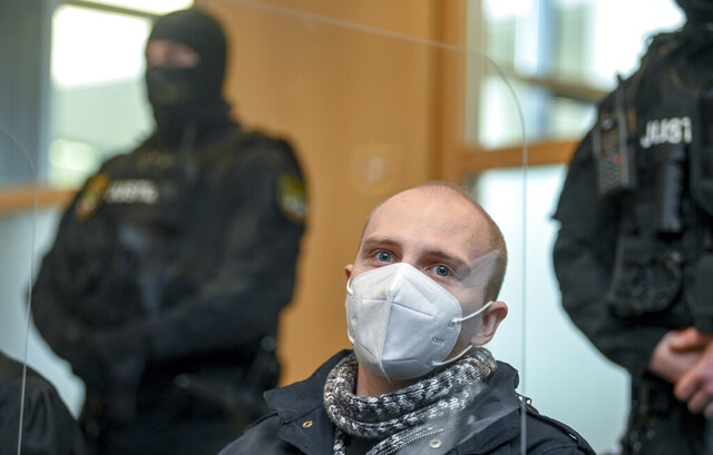 The defendant Stephan Balliet sits in the courtroom of the district court on the 26th day of the trial before the court's verdict in Magdeburg, Germany, Monday, Dec. 21, 2020. The Federal Prosecution accuses the Halle assassin of 13 crimes, including murder and attempted murder. The assassin had tried to cause carnage in the synagogue in Halle on Oct.19, 2019 on the highest Jewish holiday Yom Kippur. (Hendrik Schmidt/Pool via AP)