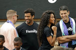 From left to right, hip-hop artist Macklemore, Seattle Seahawks NFL football quarterback Russell Wilson, Wilson's wife, pop singer Ciara, and former Microsoft executive Terry Myerson visit Monday, Aug. 19, 2019, during an event in Seattle held to introduce themselves and others as new members of the MLS soccer Seattle Sounders team's ownership group. (AP Photo/Ted S. Warren)