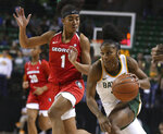 Baylor guard Te'a Cooper, right, drives past Georgia guard Chloe Chapman, left, on a fast break in the second half of an NCAA college basketball game, Wednesday, Dec. 4, 2019, in Waco, Texas. (Rod Aydelotte/Waco Tribune-Herald via AP)