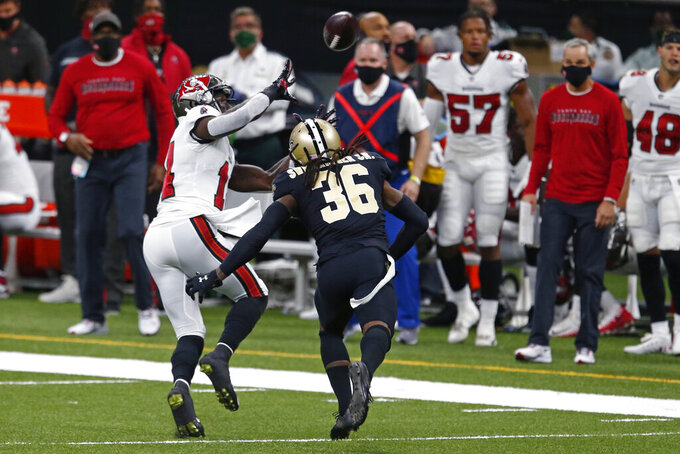 Tampa Bay Buccaneers wide receiver Chris Godwin pulls in a pass against New Orleans Saints free safety D.J. Swearinger (36) in the first half of an NFL football game in New Orleans, Sunday, Sept. 13, 2020. (AP Photo/Butch Dill)