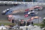 CORRECTS TO 14TH LAP, NOT 13TH AS ORIGINALLY SENT - Cars collide on the 14th lap during the NASCAR Daytona 500 auto race at Daytona International Speedway, Sunday, Feb. 14, 2021, in Daytona Beach, Fla. (AP Photo/Chris O'Meara)