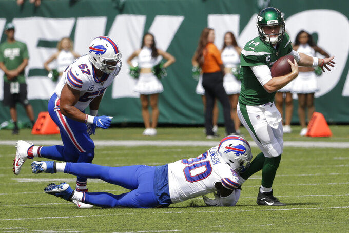 Buffalo Bills' Shaq Lawson (90) sacks New York Jets quarterback Sam Darnold (14) during the first half of an NFL football game Sunday, Sept. 8, 2019, in East Rutherford, N.J. (AP Photo/Seth Wenig)