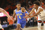 UCLA's Jaylen Hands dodges Oregon State's Stephen Thompson Jr. during the first half of an NCAA college basketball game in Corvallis, Ore., Sunday, Jan. 13, 2019. (AP Photo/Amanda Loman)