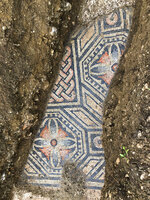 A view of a well-preserved colorful mosaic floor of an ancient Roman villa archaeologists have revealed among vineyards near the northern city of Verona, Italy. The official in charge of archaeology Verona province, Gianni De Zuccato, on Friday, May 29, 2020, said the mosaics appeared to be ''in a good state of conservation,'' from what they are able to observe after gingerly digging a trench between vineyards in the hills of Valpolicella, known for its full-bodied red wine. (Soprintendenza ABAP Verona via AP)