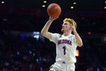Arizona guard Nico Mannion shoots against Washington State during the second half of an NCAA college basketball game Thursday, March 5, 2020, in Tucson, Ariz. Arizona won 83-62. (AP Photo/Rick Scuteri)