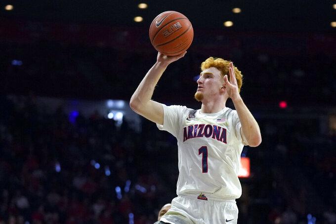 Arizona guard Nico Mannion shoots against Washington State during the second half of an NCAA college basketball game Thursday, March 5, 2020, in Tucson, Ariz. Arizona won 83-62. (AP Photo/Rick Scuteri)