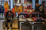 In this Friday, Oct. 11, 2019, photo, a sales person adjust a mascot doll at a NBA merchandise store in Beijing. When Houston Rockets' general manager Daryl Morey tweeted last week in support of anti-government protests in Hong Kong, everything changed for NBA fans in China. A new chant flooded Chinese sports forums: