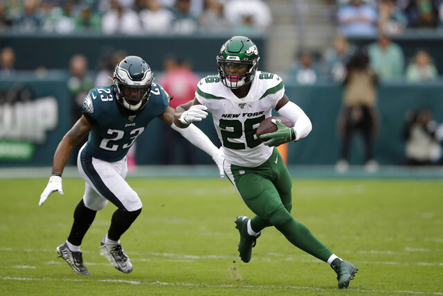 File-This Oct. 6, 2019, file photo shows New York Jets' Le'Veon Bell, right, rushing past Philadelphia Eagles' Rodney McLeod during the first half of an NFL football game in Philadelphia. The New York Jets have surprisingly released Bell, ending a disappointing tenure after less than two full seasons. The team issued a statement from general manager Joe Douglas on Tuesday, Oct. 13, 2020, in which he says the Jets made the move after having several conversations with Bell and his agent during the last few days and exploring trade options. (AP Photo/Matt Rourke, File)