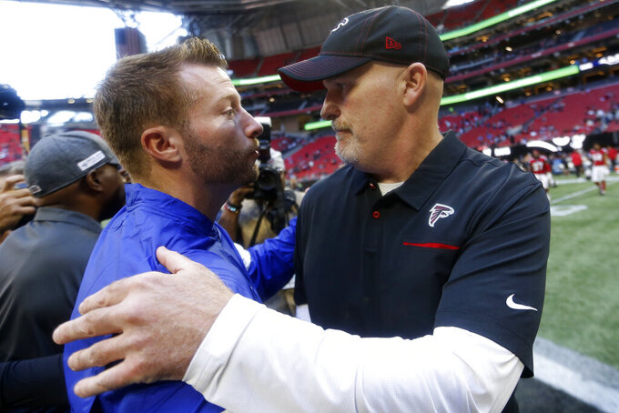 Los Angeles Rams head coach Sean McVay, ledft speaks with Atlanta Falcons head coach Dan Quinn after an NFL football game, Sunday, Oct. 20, 2019, in Atlanta. The Los Angeles Rams won 37-10. (AP Photo/John Bazemore)