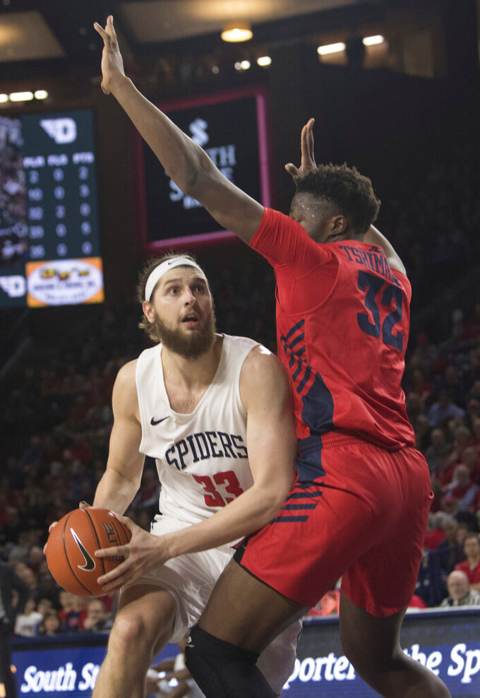 Richmond forward Grant Golden (33) drives under the basket against Dayton defender Jordy Tshimanga (32) during the first half of an NCAA college basketball game in Richmond, Va., Saturday, Jan. 25, 2020.(AP Photo/Lee Luther Jr.)