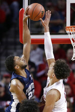 Nebraska's Isaiah Roby, right, blocks a shot by Penn State's Josh Reaves (23) during the first half of an NCAA college basketball game in Lincoln, Neb., Thursday, Jan. 10, 2019. (AP Photo/Nati Harnik)