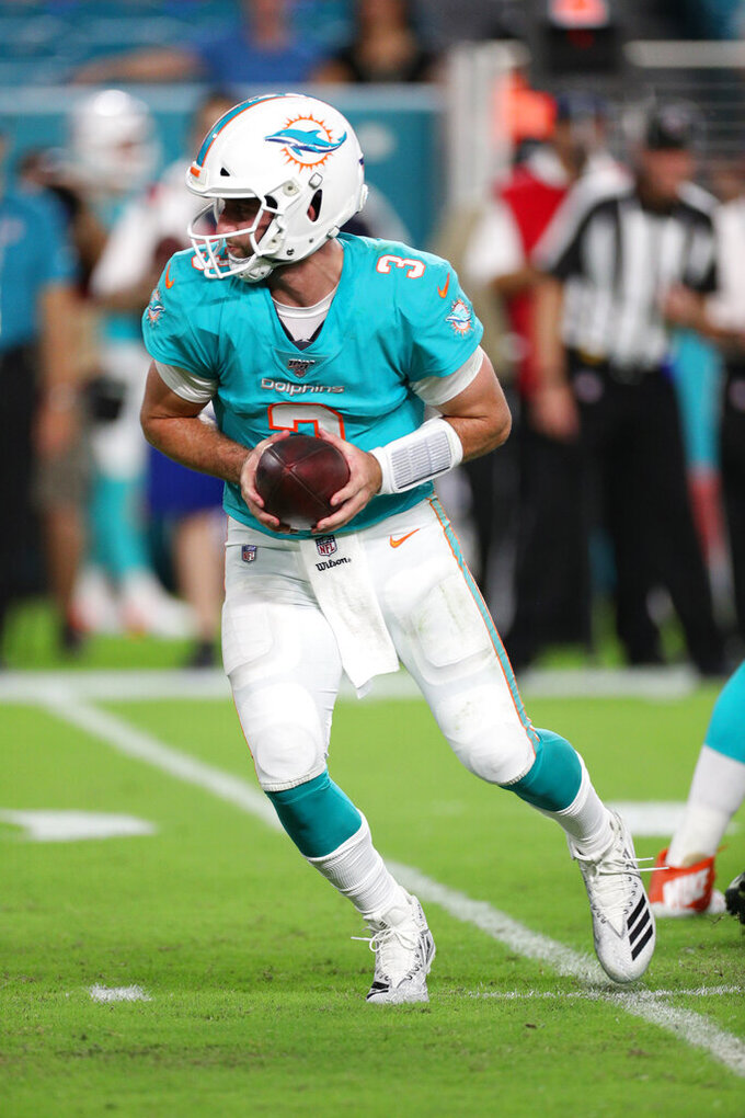 Miami Dolphins quarterback Josh Rosen (3) prepares to hand the ball off in an NFL preseason game against the Jacksonville Jaguars, Thursday, Aug. 22, 2019, in Miami Gardens, Fla. (Margaret Bowles via AP)