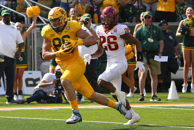 Baylor tight end Ben Sims (86) runs for a touchdown past Iowa State defensive back Anthony Johnson Jr. (26) after a catch during the first half of an NCAA college football game, Saturday, Sept. 25, 2021, in Waco, Texas. (AP Photo/Jim Cowsert)