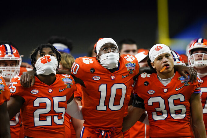Clemson gathers after their loss against Ohio State in the Sugar Bowl NCAA college football game Friday, Jan. 1 2021, in New Orleans. Ohio State won 49-28. (AP Photo/Gerald Herbert)
