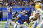 Detroit Lions wide receiver Danny Amendola, left, throws a 19-yard touchdown pass to quarterback David Blough during the first half of an NFL football game against the Green Bay Packers, Sunday, Dec. 29, 2019, in Detroit. (AP Photo/Rick Osentoski)