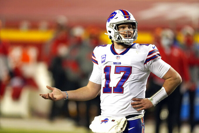 Buffalo Bills quarterback Josh Allen questions a call during the first half of the AFC championship NFL football game against the Kansas City Chiefs, Sunday, Jan. 24, 2021, in Kansas City, Mo. (AP Photo/Charlie Riedel)