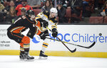 Boston Bruins center Joakim Nordstrom, right, passes the puck while under pressure from Anaheim Ducks defenseman Cam Fowler during the first period of an NHL hockey game Friday, Feb. 15, 2019, in Anaheim, Calif. (AP Photo/Mark J. Terrill)